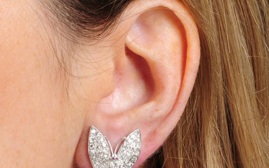 A pair of mid 20th century platinum diamond butterfly earrings.
