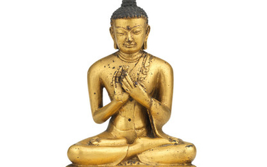 A rare gilt copper-alloy figure of Shakyamuni Buddha