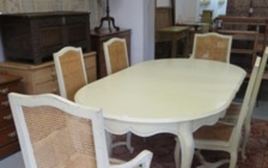A shabby chic set of table and chairs, the chairs with woven...