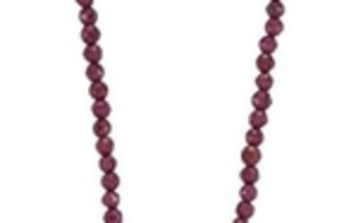 A ruby and garnet necklace, the pear-shaped...