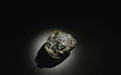 A RARE SILVER-INLAID BRONZE 'BEAST HEAD' CHARIOT ORNAMENT WARRING STATES PERIOD - HAN DYNASTY