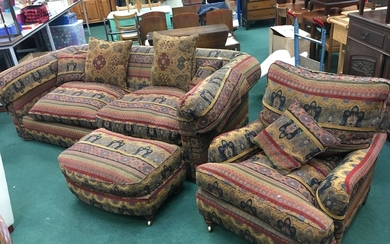 A large fabric covered sofa with floral design, together wit...