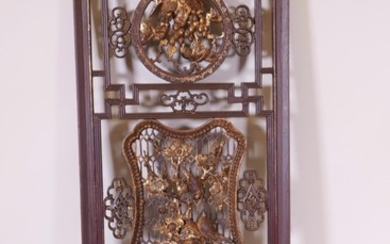 A Chinese lacquer panel, carved and pierced with parcel gilt...