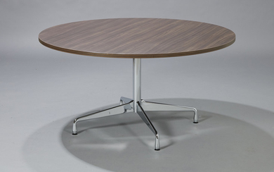 Charles Eames. Round dining table/'Segmented Table' in walnut