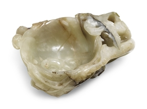 A CELADON JADE 'MALLOW' LIBATION CUP LATE MING DYNASTY