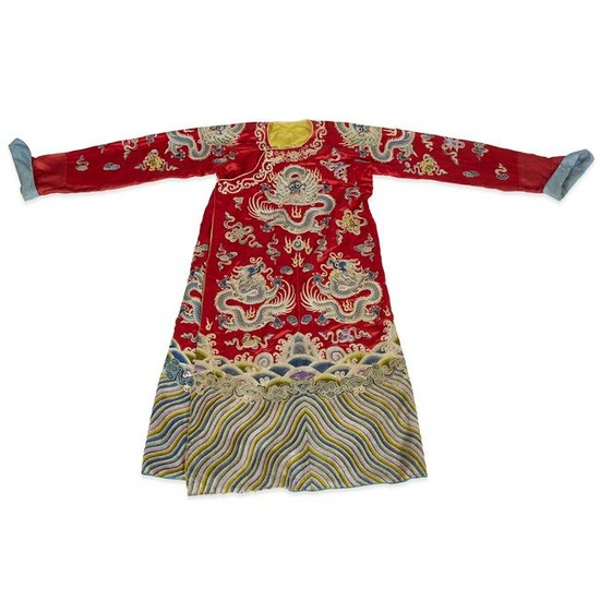 A Chinese embroidered red silk dragon robe, Qing