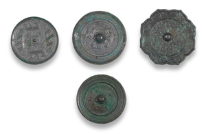 A group of four archaic bronze mirrors