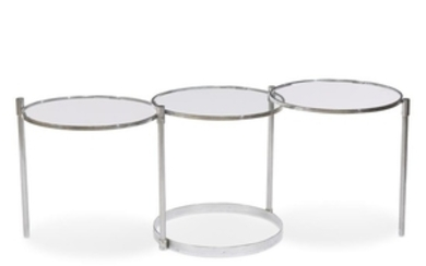 A chromed metal and glass swiveling cocktail table second...