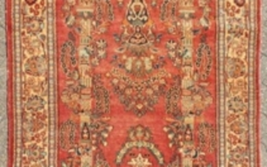 A PERSIAN KASHAN RUG with floral central motifs on a