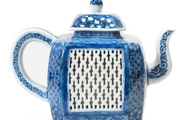 A blue and white reticulated teapot and cover