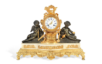 A late 19th century French gilt and patinated bronze figural mantel clock