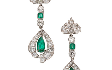 Emerald, Diamond, Platinum Earrings The earrings feature pear-shaped and...