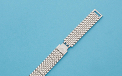 A stainless steel Heuer 'Monaco' bracelet with end links and additional loose links