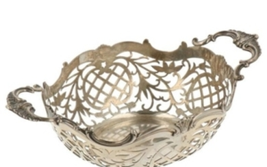Bonbon basket with ajour openwork side and decorated molded soldered handles silver.