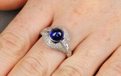 A sapphire cabochon and brilliant and tapered baguette-cut diamond dress ring.