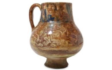 A RAQQA COPPER-LUSTRE POTTERY JUG Syria, 13th cent