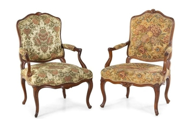 A Pair of Louis XV Style Carved Walnut Fauteuils