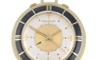 A gold plated alarm travel clock by Jaeger-LeCoultre.