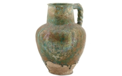 A BLACK-PAINTED TURQUOISE-GLAZED WATER JUG Possibl