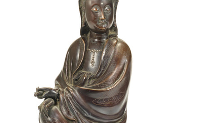 A silver-wire-inlaid bronze figure of Guanyin