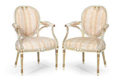 A pair of George III painted and parcel gilt armchairs