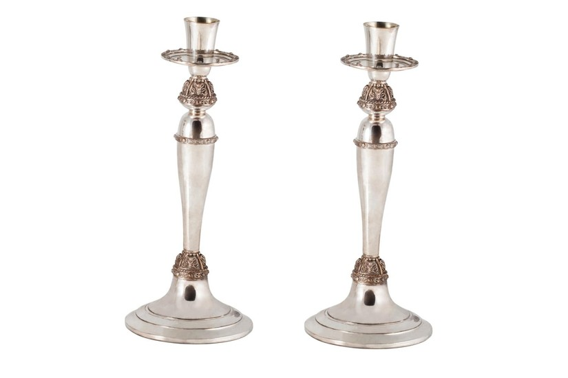 A PAIR OF MODERN IRISH SILVER CANDLE STICKS, with applied Ce...