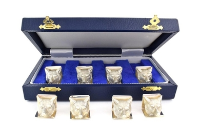 A Set of Eight Elizabeth II Silver Place-Card Holders, by...