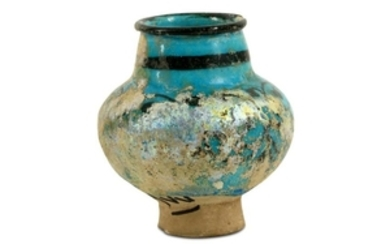 A SMALL BLACK-PAINTED TURQUOISE-GLAZED JAR Kashan,