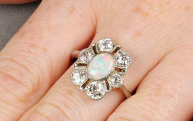 An early 20th century 18ct gold opal and old-cut diamond cluster ring.