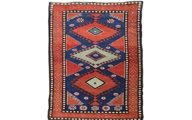 AN UNUSUAL ANTIQUE KURDISH RUG