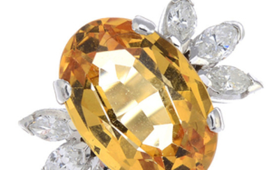 A yellow topaz and diamond cocktail ring.