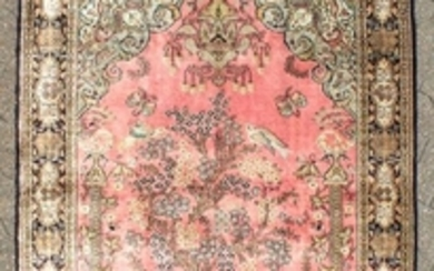 A FINE PERSIAN SILK QUM RUG with a tree pattern and