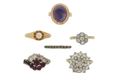 Seven gem-set rings, including a diamond cluster ring,...