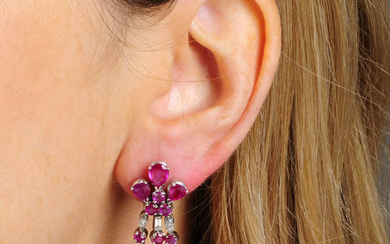 A pair of ruby and diamond fringe earrings.
