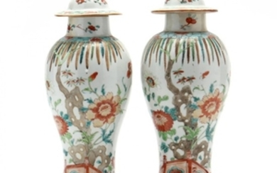 A Pair of Chinese Porcelain Covered Vases with Stands