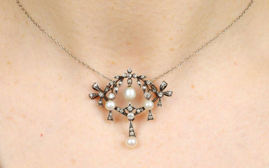 An early 20th century silver and gold, pearl and diamond necklace.