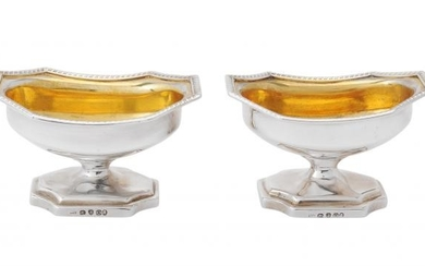 A pair of George III silver pedestal salt cellars by William Abdy II