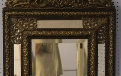 Baroque style pressed metal and wood wall mirror