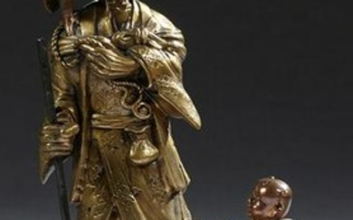 Japanese Bronze Figural Group, early 20th c., of a man