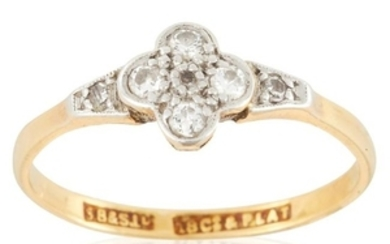 A DIAMOND DRESS RING in 18ct yellow gold, set with