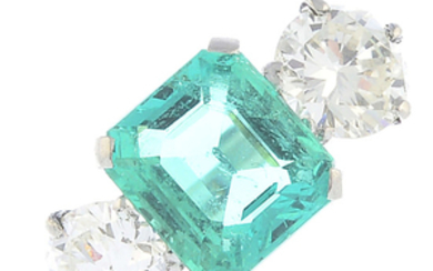 A Colombian emerald and diamond three-stone ring.