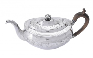 A George III Irish silver oval tea pot by Robert Breading
