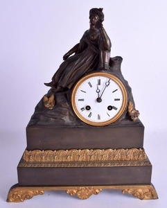 A 19TH CENTURY FRENCH BRONZE MANTEL CLOCK modelled with