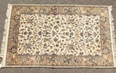 A GOOD INDIAN WOOL RUG with hunting scenes on a white