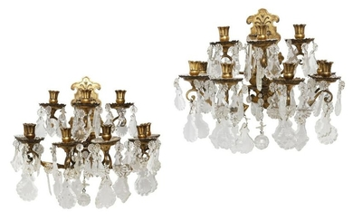 A pair of gilt bronze and cut glass wall sconces
