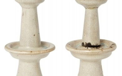 A pair of Chinese stoneware candlesticks, late...