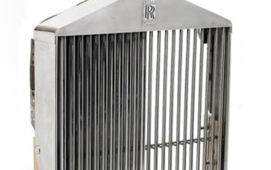 A Rolls-Royce radiator surround with mascot,