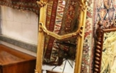 A LONG THIN CROSS FRAMED MIRROR. 5ft 8ins high x 1ft