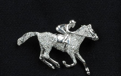 An 18ct gold diamond horse and jockey brooch.Engraved
