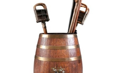 AN OAK AND BRASS BOUND UMBRELLA STAND, painted wit…
